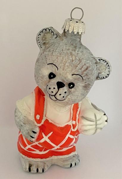 Bären Junge in roten Latzhosen, mit Ball