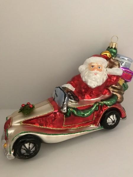 Santa bringt die Geschenke mit dem Oldtimer-Cabrio