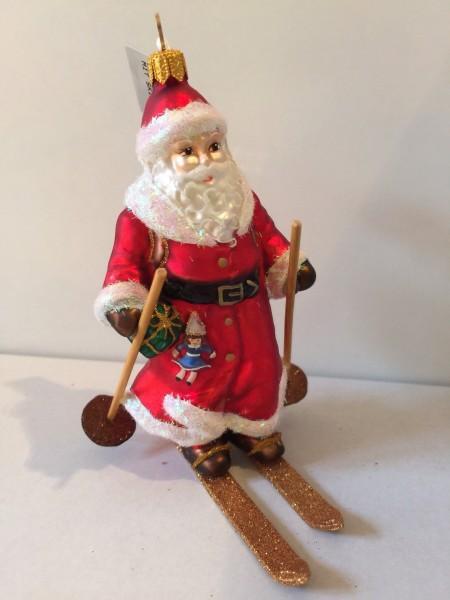 Weihnachtsmann auf Ski mit Geschenksack