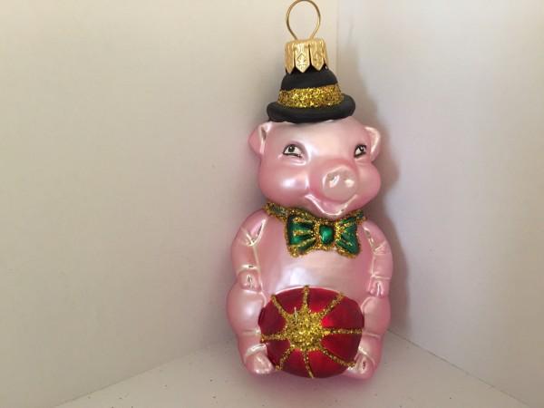 rosa Glücksschweinchen mit Ball