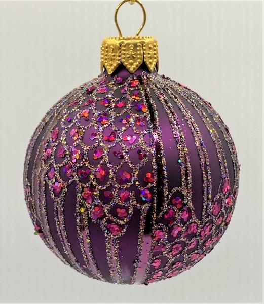 Kugel violett verziert mit Tupfen und Streifen