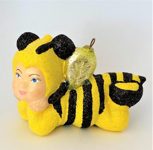 Kind im Bienenkostüm, KOMOZJA MOSTOWSKI