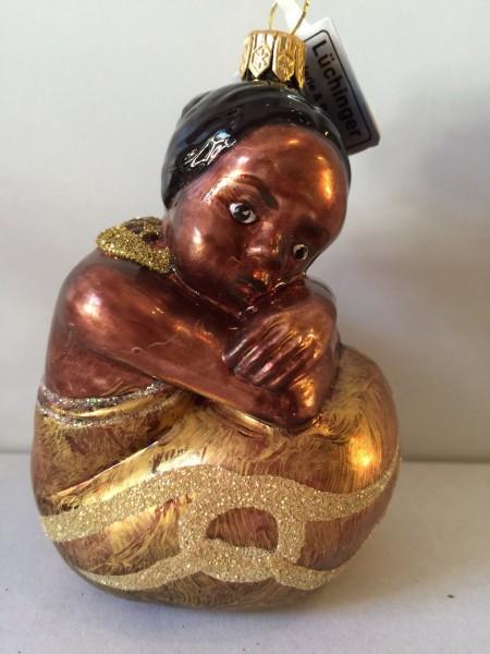 Afrikanisches Mädchen, sitzend