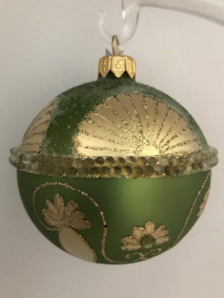 Grüne Kugel mit goldenem Art-Deko Muster