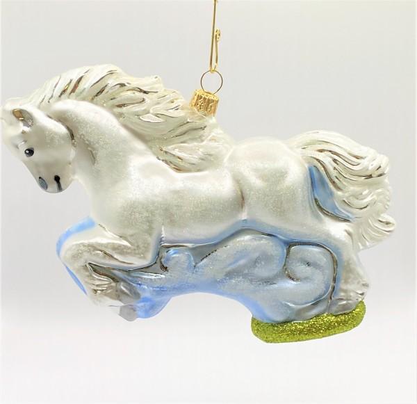 Weisses Pferd im Sprung