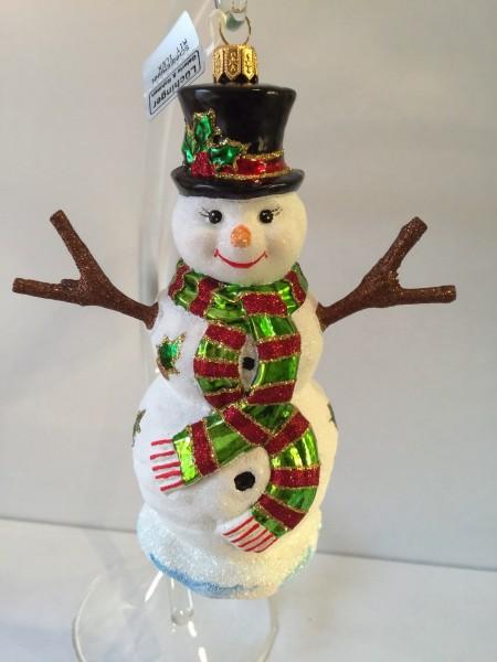 Schneemann mit Schal und Stechlaub