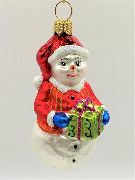 Kleiner Schneemann mit roter Jacke