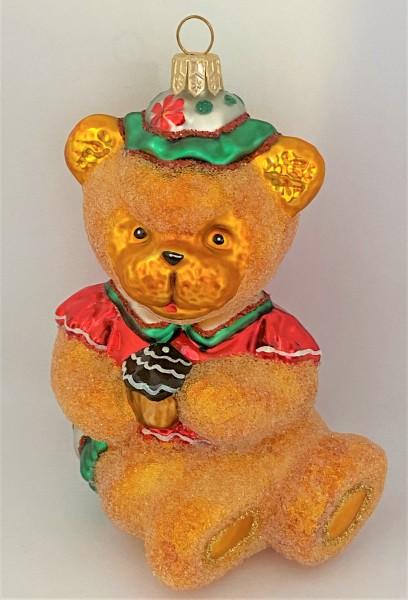 Teddybär mit Cup-Cake in den Pfoten